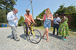 Casmil Ngundakumana, a refugee from Rwanda, prepares to ride a bike in Durham, North Carolina, on July 22, 2017. He gets help from Greg Garneau, a volunteer who coordinates the refugee bike program for the Durham Bicycle Co-op, and Monique Lohmeyer, a case manager for Church World Service. <br /> <br /> Church World Service resettles refugees in North Carolina and throughout the United States.<br /> <br /> Photo by Paul Jeffrey for Church World Service.