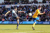 Luke O'Nien of Wycombe Wanderers (left) shoots during the Sky Bet League 2 match between Wycombe Wanderers and Mansfield Town at Adams Park, High Wycombe, England on 25 March 2016. Photo by David Horn.
