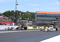 May 15, 2016; Commerce, GA, USA; NHRA top fuel driver Steve Torrence (left) races alongside Antron Brown during the Southern Nationals at Atlanta Dragway. Mandatory Credit: Mark J. Rebilas-USA TODAY Sports