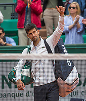 Paris, France, 7 June, 2017, Tennis, French Open, Roland Garros, Seccond deed Novak Djokovic (SRB) waves to the crowd after his defeat by Dominic Thiem (AUT)<br /> Photo: Henk Koster/tennisimages.com