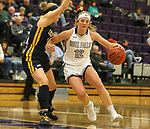 SIOUX FALLS, SD - DECEMBER 7: Kaely Hummel #12 from the University of Sioux Falls drives against Anna Schmitt #11 from Concordia St. Paul during their game Friday night at the Stewart Center in Sioux Falls, SD. (Photo by Dave Eggen/Inertia)