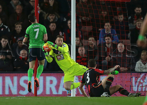 01.03.2016. Vitality Stadium, Bournemouth, England. Barclays Premier League. Bournemouth versus Southampton. Bournemouth Goalkeeper Artur Boruc gathers the ball from a Southampton cross, as Southampton Forward Shane Long puts in a challenge