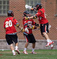 Michael Shakespeare (10) and Ryan Young (27) of Maryland celebrate a goal as teammate Scott LaRue (20) moves in during the ACC men's lacrosse tournament finals in College Park, MD.  Virginia defeated Maryland, 10-6.