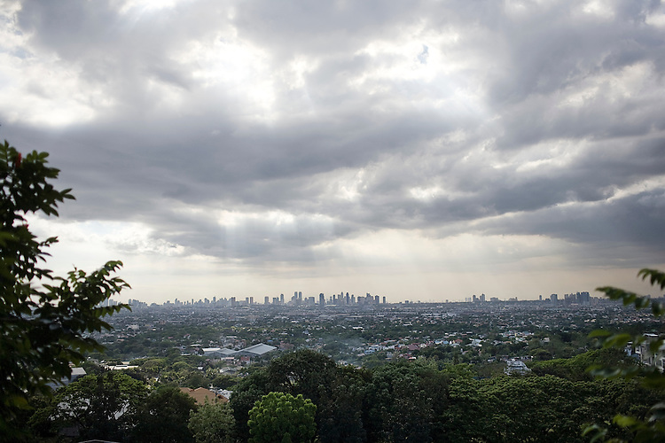 Metro Manila is seen rising in the distance from the municipality of Cainta in Rizal province.