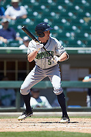 Peter Bourjos (5) of the Gwinnett Stripers runs his hands up the bat to bunt during the game against the Charlotte Knights at BB&T BallPark on May 2, 2018 in Charlotte, North Carolina.  The Knights defeated the Stripers 6-5.  (Brian Westerholt/Four Seam Images)