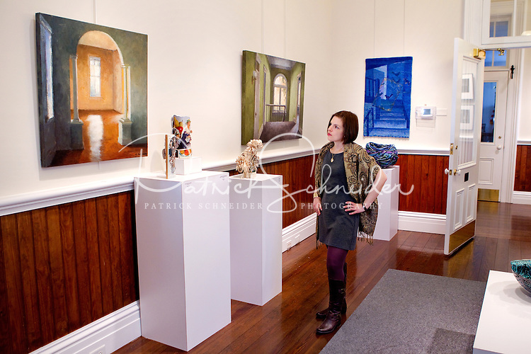 Photographic portrait of Jennifer Livingston in the art galleries located in the 1876 historic Cabarrus courthouse. The Galleries display works by regional and national artists working in a variety of media. Photo is part of a photographic series of images featuring Concord, NC, by Charlotte-based photographer Patrick Schneider...