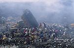 Asia, Philippines, Manilla, Smokey Mountain Rubbish dump. Thousands of poor and often indigenous people work sifting through the rubbish, recycling materials such as paper, various metal and plastic. They earn about $1 a day. The place is rife with disease. Photograph © Nigel Dickinson