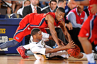 21 January 2012:  FIU center Brandon Moore (22) and FAU guard-forward Jordan McCoy (21) battle over a loose ball in the second half as the Florida Atlantic University Owls defeated the FIU Golden Panthers, 66-64, at the U.S. Century Bank Arena in Miami, Florida.