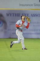 Greeneville Reds left fielder Nate Scantlin (17) tracks a fly ball during the game against the Pulaski Yankees at Calfee Park on June 23, 2018 in Pulaski, Virginia. The Reds defeated the Yankees 6-5.  (Brian Westerholt/Four Seam Images)