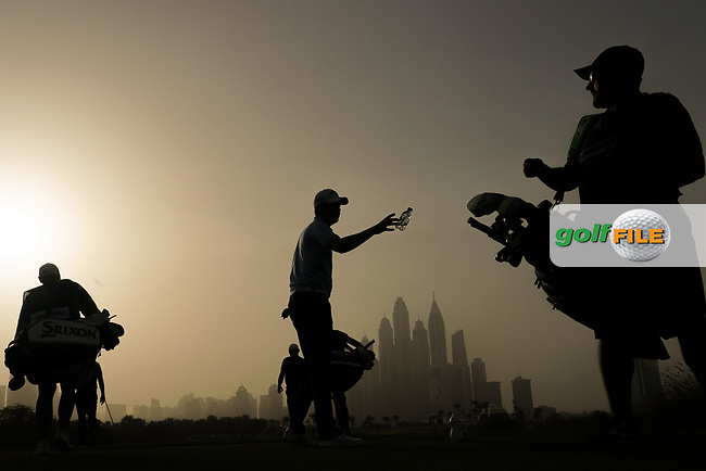 Caddies and a group leave the 8th tee during the first round of the Omega Dubai Desert Classic, Emirates Golf Club, Dubai, UAE. 24/01/2019<br /> Picture: Golffile | Phil Inglis<br /> <br /> <br /> All photo usage must carry mandatory copyright credit (&copy; Golffile | Phil Inglis)