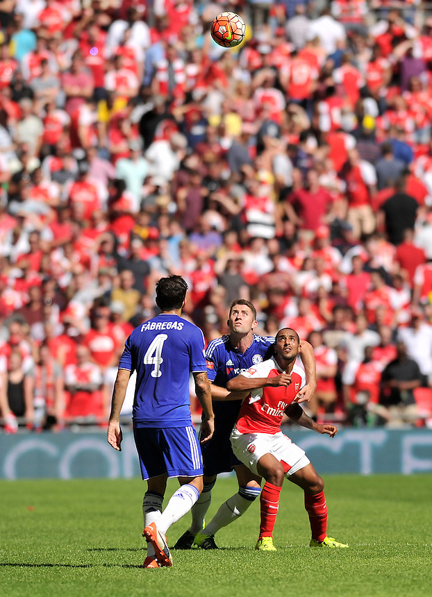 Arsenal's Theo Walcott holds off the challenge from Chelsea's Gary Cahill<br /> <br /> Photographer Ashley Western/CameraSport<br /> <br /> Football - FA Community Shield - Arsenal v Chelsea - Sunday 2nd August 2015 - Wembley Stadium - London<br /> <br /> &copy; CameraSport - 43 Linden Ave. Countesthorpe. Leicester. England. LE8 5PG - Tel: +44 (0) 116 277 4147 - admin@camerasport.com - www.camerasport.com