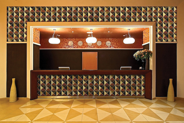 Custom Christopher hotel lobby reception shown in glass Carnelian, Tortoise Shell, Tiger's Eye, Amber