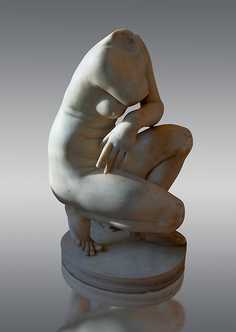 Crouching Aphrodite (Venus). 2nd Century Imperial Roman Marble Statue from Italy. Louvre Museum, Paris. Cat No MR 372<br /> This sculpture  is a variation on the Classic Hellanistic 3rd to Ist century BC style of Aphrodite crouching to bathe. Aphrodite crouches with her right knee close to the ground, turns her head to the right as if looking at somebody and, in most versions, reaches her right arm over to her left shoulder to cover her breasts.