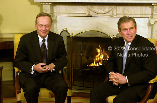 United States President George W. Bush, right, meets The Prime Minister Jean Chrétien, left, of Canada in the Oval Office of the White House in Washington, D.C. on February 5, 2001..Credit: Ron Sachs / CNP