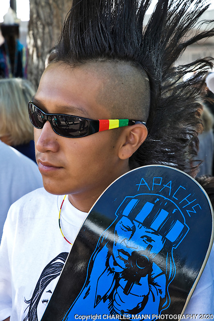 Apache Forrest Titla poses with his skateboard before entering the Native American Costume Contest a the 2009 Santa Fe Indian Market.