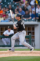 Connor Gillaspie (12) of the Chicago White Sox follows through on his swing against the Charlotte Knights at BB&T Ballpark on April 3, 2015 in Charlotte, North Carolina.  The Knights defeated the White Sox 10-2.  (Brian Westerholt/Four Seam Images)