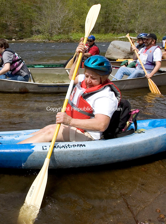 WATERBURY, CT. 05 May 2011-050711SV02--Sue Salzer of Watertown gets ready to head down the Naugatuck River on Platts Mill Road in Waterbury Saturday. Kayakers and canoe racers paddled 6 miles from Waterbury to Beacon Falls during the 4th Annual Naugatuck Valley River Race and Festival. The event was sponsored Connecticut Outdoors, LLC and Beacon Falls Merchant Association.<br /> Steven Valenti Republican-American