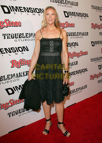 "KELLY LYNCH.attends Dimension Films' World Premiere of ""Sin City"" held at The Mann National Theater in Westwood, California, USA, on March 28th 2005..full length black dress.Ref: DVS.www.capitalpictures.com.sales@capitalpictures.com.©Debbie VanStory/Capital Pictures"