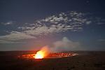 The Halema'uma'u Crater in the Kilauea Caldera glows under the stars of a night sky in Volcano National Park, The Big Island of Hawai'i, Hawai'i, USA