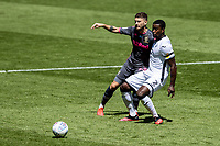 Leeds United's Mateusz Klich competing with Swansea City's Marc Guehi (right) <br /> <br /> Photographer Andrew Kearns/CameraSport<br /> <br /> The EFL Sky Bet Championship - Swansea City v Leeds United - Sunday 12th July 2020 - Liberty Stadium - Swansea<br /> <br /> World Copyright © 2020 CameraSport. All rights reserved. 43 Linden Ave. Countesthorpe. Leicester. England. LE8 5PG - Tel: +44 (0) 116 277 4147 - admin@camerasport.com - www.camerasport.com