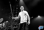 OAKLAND, CA - DECEMBER 03:  (EDITORS NOTE: This image has been converted to black and white.)  Singer Nick Jonas performs onstage during WiLD 94.9's FM's Jingle Ball 2015 presented by Capital One at ORACLE Arena on December 3, 2015 in Oakland, California.  (Photo by Kevin Winter/Getty Images for iHeartMedia)