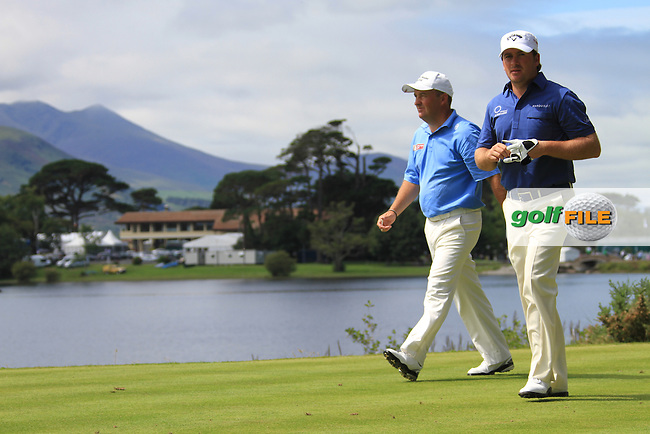 Damien McGrane and Graeme McDowell walking off the 3rd tee during the first round of the 3 Irish Open, at the Killarney Golf and Fishing Club, Killarney, Ireland.Picture Fran Caffrey/www.golffile.ie.