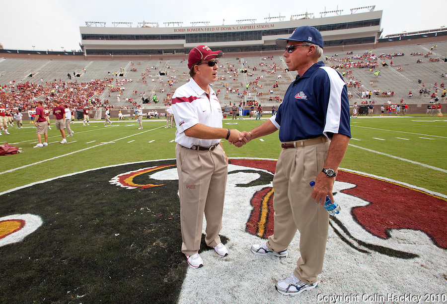 TALLAHASSEE, FL 9/4/10-FSU-SAMFORD FB10 CH-Florida State Head Coach Jimbo Fisher, right, greets Samford Head Coach Pat Sullivan prior to the game Saturday at Doak Campbell Stadium in Tallahassee. The Seminoles beat the Bulldogs 59-6 to give Head Coach Jimbo Fisher his first victory..COLIN HACKLEY PHOTO