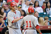 Philadelphia Phillies OF Jayson Werth greets Jimmy Rollins (11) after he scores against the Houston Astros on Turn Back the Clock Nite. Game played on Saturday April 10th, 2010 at Minute Maid Park in Houston, Texas.  (Photo by Andrew Woolley / Four Seam Images)