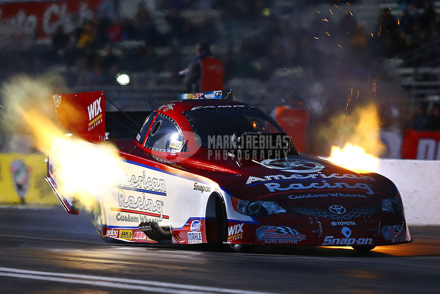 Feb 7, 2014; Pomona, CA, USA; NHRA funny car driver Tony Pedregon during qualifying for the Winternationals at Auto Club Raceway at Pomona. Mandatory Credit: Mark J. Rebilas-