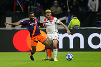 Raheem Sterling of Manchester City tackles Lyon's Fernando Marcal during Lyon vs Manchester City, UEFA Champions League Football at Groupama Stadium on 27th November 2018