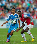 Johan Djourou of Arsenal and and Cheng Siu Wai of Kitchee in action during the pre-season Asian Tour friendly match against at the Hong Kong Stadium on July 29, 2012. Photo by Victor Fraile / The Power of Sport Images
