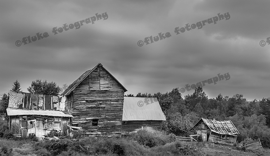 "Originally titled ""Weathered Old Farm,"" when a friend was looking at this picture, he muttered, ""Home Sweet Home.""  It was taken somewhere west and south of Yellowstone National Park."