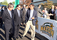 John Harkes talks to Harold Mayne-Nicholls and Danny Jordaan during the visit of the FIFA World Cup 2018-2022 inspection delegation to George Mason University soccer practice facility.