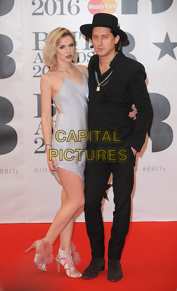 LONDON, ENGLAND - FEBRUARY 24: Carl Barat and Edie Langley attend the Brit Awards 2016 at The O2 Arena in London on February 24, 2016 in London, England.<br /> CAP/BEL<br /> &copy;Tom Belcher/Capital Pictures