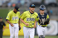 Pitching coach Josh Towers (19) of the Columbia Fireflies trots off the mound after a conference with the pitcher and catcher in a game against the Augusta GreenJackets on Thursday, July 11, 2019 at Segra Park in Columbia, South Carolina. Columbia won, 5-2. (Tom Priddy/Four Seam Images)