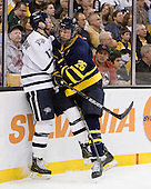 Paul Thompson (UNH - 17), Adam Ross (Merrimack - 26) - The Merrimack College Warriors defeated the University of New Hampshire Wildcats 4-1 (EN) in their Hockey East Semi-Final on Friday, March 18, 2011, at TD Garden in Boston, Massachusetts.