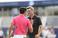 Ross Fisher (ENG) and Haotong Li (CHN) on the 18th green during the 3rd round of the DP World Tour Championship, Jumeirah Golf Estates, Dubai, United Arab Emirates. 17/11/2018<br /> Picture: Golffile | Fran Caffrey<br /> <br /> <br /> All photo usage must carry mandatory copyright credit (&copy; Golffile | Fran Caffrey)