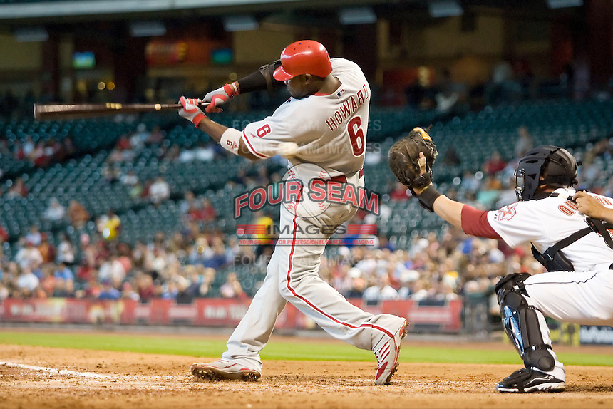 Philadelphia Phillies first baseman Ryan Howard #6 swings and misses during the Major League Baseball game against the Houston Astros at Minute Maid Park in Houston, Texas on September 14, 2011. Philadelphia defeated Houston 1-0 to clinch a playoff berth.  (Andrew Woolley/Four Seam Images)