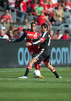 05 May 2012: D.C. United midfielder Branko Boskovic #8 and Toronto FC forward/midfielder Ryan Johnson #9 in action during an MLS game between DC United and Toronto FC at BMO Field in Toronto..D.C. United won 2-0.