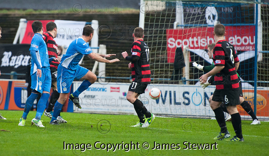 Queen of the South's Ryan McGuffie scores their first goal.