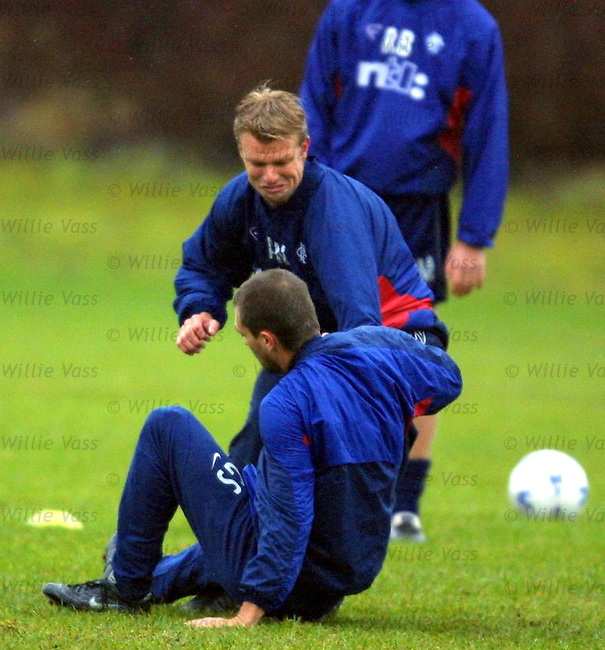 Arthur Numan decks Sergio Porrini at training at Stepps
