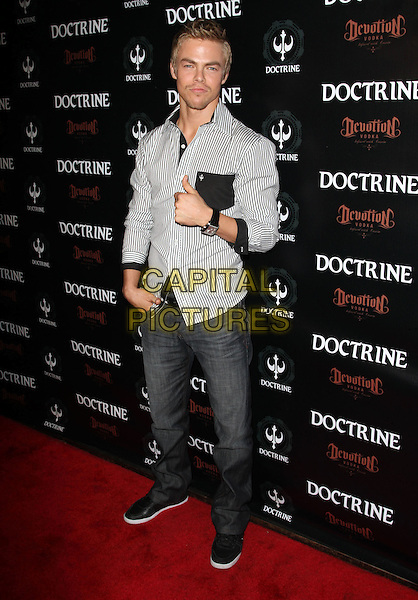 DEREK HOUGH .Doctrine Clothing and Devotion Vodka Launch held at Sky Bar at Boudoir, West Hollywood, CA, USA, .12th October 2010..full length grey gray jeans white pinstripe striped shirt black trainers pocket thumb up gesture .CAP/ADM/KB.©Kevan Brooks/AdMedia/Capital Pictures.