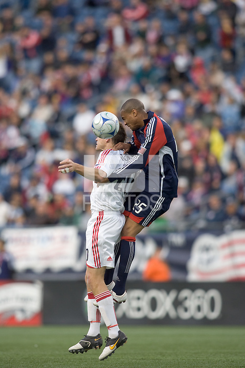 Chicago Fire forward Brian McBride (20) and New England Revolution defender Darrius Barnes (25) battle for head ball. The New England Revolution out scored the Chicago Fire, 2-1, in Game 1 of the Eastern Conference Semifinal Series at Gillette Stadium on November 1, 2009.