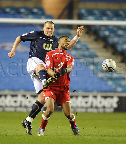 29.01.2011 Championship Football from the New Den. Millwall v Barnsley. Millwall won 2-0. Millwalls Darren Purse clears from Barnsleys Danny Haynes