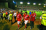 Barnsley 0 Huddersfield Town 1, 12/05/2006. Oakwell, League One Play Off Semi Final 1st Leg. Barnsley (red shirts) versus Huddersfield Town, Coca-Cola League One play-off semi-final first leg at Oakwell, Barnsley. The visitors won one-nil with a goal from Gary Taylor-Fletcher in 85 minutes. Picture shows Barnsley's Anthony Kay (left) and Paul Heckingbottom leave the field as the police line up for the after-match entertainment. Photo by Colin McPherson.
