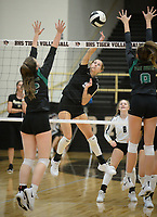 NWA Democrat-Gazette/ANDY SHUPE<br /> Bentonville's Ava Hoyord (center) sends the ball over the net Tuesday, Sept. 10, 2019, as Van Buren's Zoe Morrison (left) and Madalyn Doolittle (8) reach to defend during play in Tiger Arena in Bentonville. Visit nwadg.com/photos to see more photos from the match.