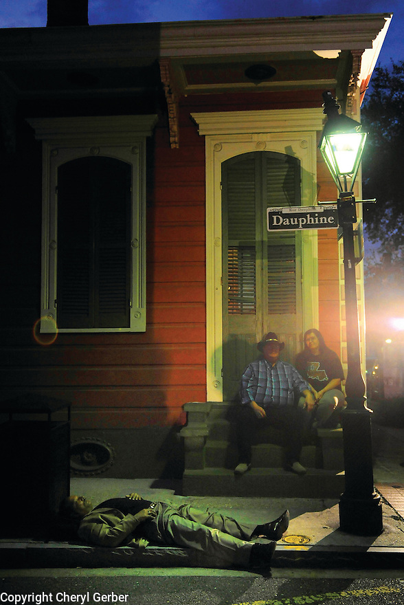 A drunk man lies on the ground in the French Quarter, 2009