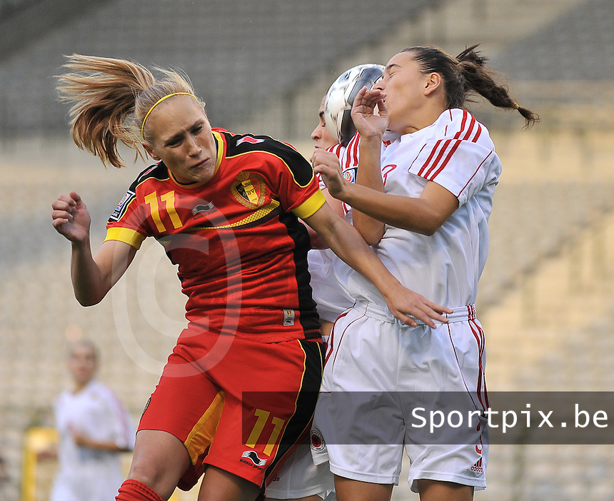 20130921 - BRUSSELS , BELGIUM : Belgian Janice Cayman (left) pictured with the header before Albanian Lulaj Cyme (right) during the female soccer match between Belgium and Albania , on the first matchday in group 5 of the UEFA qualifying round to the FIFA Women World Cup in Canada 2015 at the Koning Boudewijn Stadion , Brussels . Saturday 21th September 2013. PHOTO DAVID CATRY