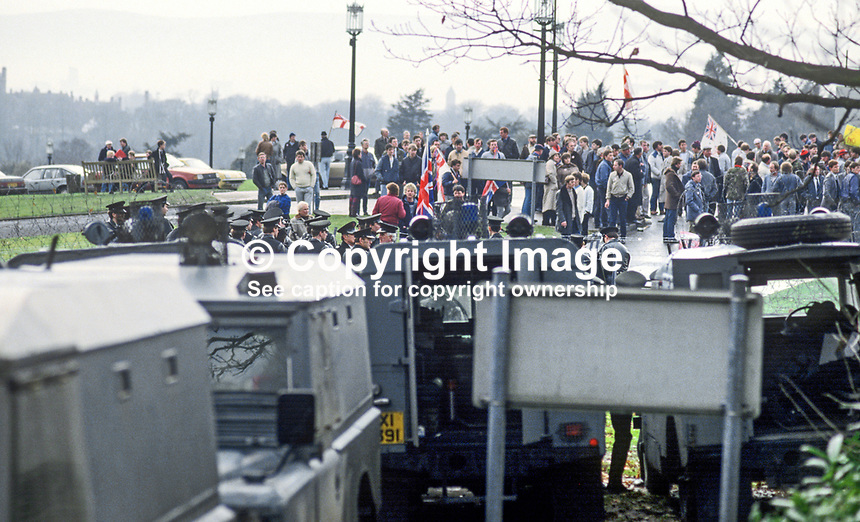Police prevent Ulster Loyalist protesters reaching Stormont Castle, Belfast, where the first working session of the Anglo-Irish Agreement was taking place attended by the UK Secretary of State for N Ireland, Tom King, and Peter Barry, Minister for Foreign Affairs, Rep of Ireland. 11th December 1985. 19851201AA1.<br /> <br /> Copyright Image from Victor Patterson, 54 Dorchester Park, <br /> Belfast, UK, BT9 6RJ<br /> <br /> t1: +44 28 9066 1296 (from Rep of Ireland 048 9066 1296)<br /> t2: +44 28 9002 2446 (from Rep of Ireland 048 9002 2446)<br /> m: +44 7802 353836<br /> <br /> e1: victorpatterson@me.com<br /> e2: victorpatterson@gmail.com<br /> www.victorpatterson.com<br /> <br /> Please see my Terms and Conditions of Use at www.victorpatterson.com. It is IMPORTANT that you familiarise yourself with them.<br /> <br /> Images used on the Internet must be visibly watermarked i.e. &copy; Victor Patterson<br /> within the body of the image and copyright metadata must not be deleted. Images <br /> used on the Internet have a size restriction of 4kbs and will be chargeable at current<br />  NUJ rates unless agreed otherwise.<br /> <br /> This image is only available for the use of the download recipient i.e. television station, newspaper, magazine, book publisher, etc, and must not be passed on to any third <br /> party. It is also downloaded on condition that each and every usage is notified within 7 days to victorpatterson@me.com<br /> <br /> The right of Victor Patterson to be identified as the author is asserted in accordance with The Copyright Designs And Patents Act (1988). All moral rights are asserted.