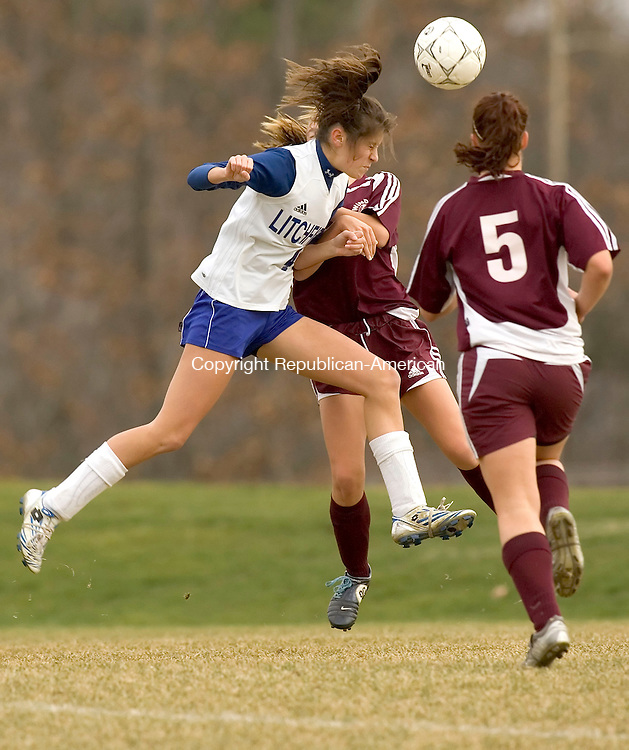 LITCHFIELD, CT-07 NOVEMBER 2006-110706JS02-Litchfield's Michaela Motta heads the ball while being defended by Windsor Locks' Kathleen Kervick and Kim Munson (5) during their Class S tournament game at Litchfield High School on Tuesday. <br /> Jim Shannon/Republican-American